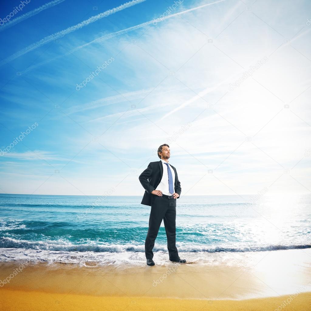 Businessman standing in sea water