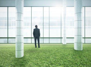 Businessman standing in bright modern office