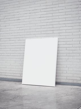 Blank poster on a brick wall
