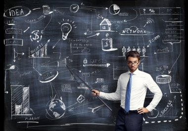 Man with pointer in his hand presenting business strategy
