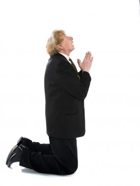 Praying businessman
