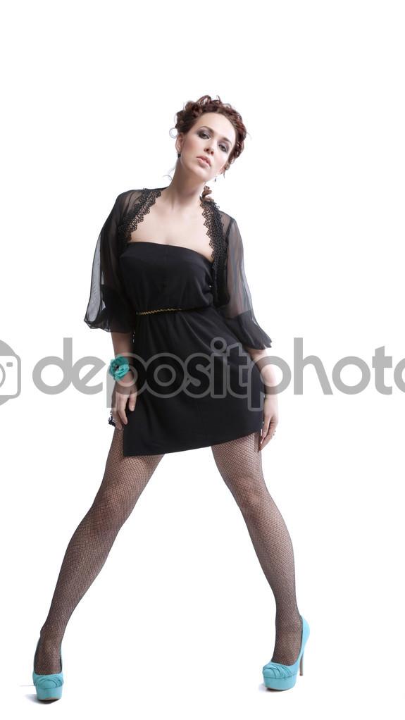 Mujer Con Un Vestido Negro Y Zapatos Altos Foto De Stock