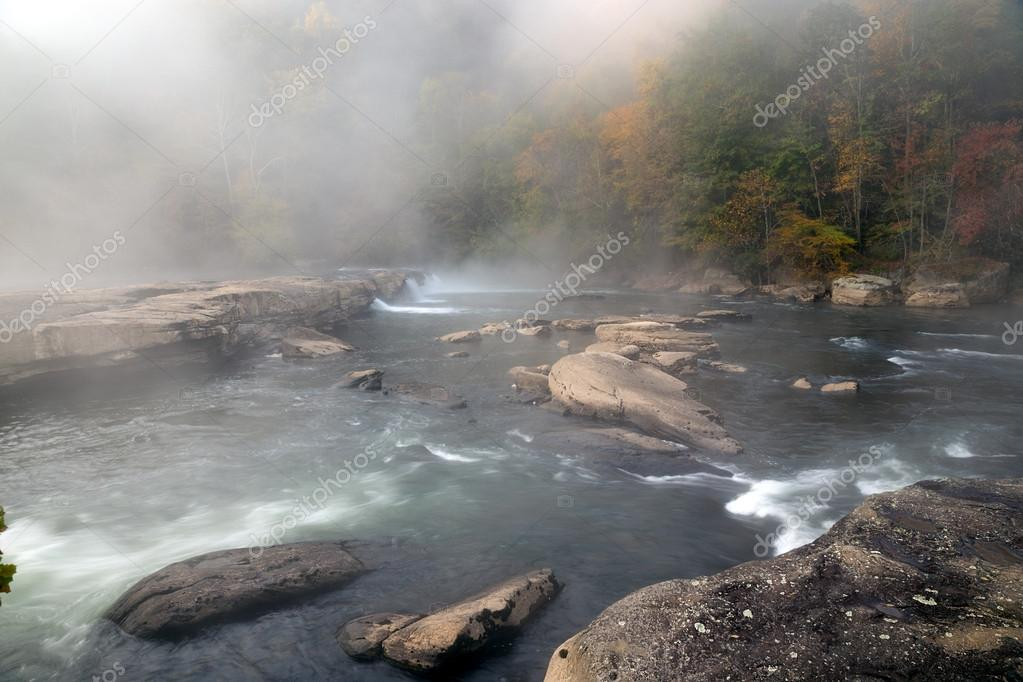 The Tygart River cascades over rocks at Valley Falls State Park