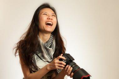 Asian photographer laugthing