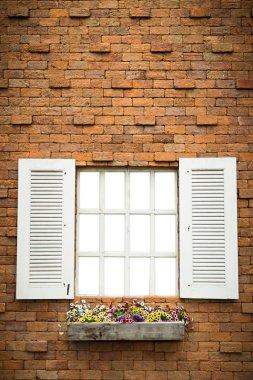 Open Window With Flower Basket On Brick  Wall