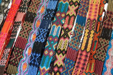 Macrame belts for sale at Mexican craft market