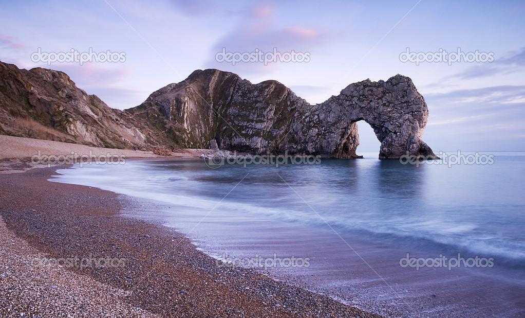 The famous rock arch Durdle Door in Dorset UK. \u2014 Photo by mparratt & Durdle Door Dorset UK. \u2014 Stock Photo © mparratt #24005191
