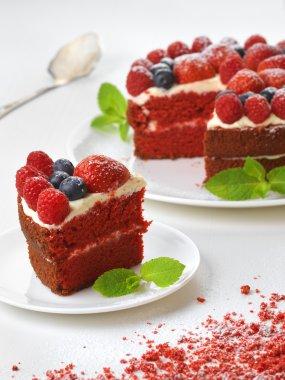 Piece of red velvet cake on plate