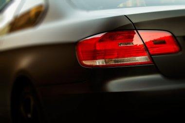 Matt black sports car. Rear View