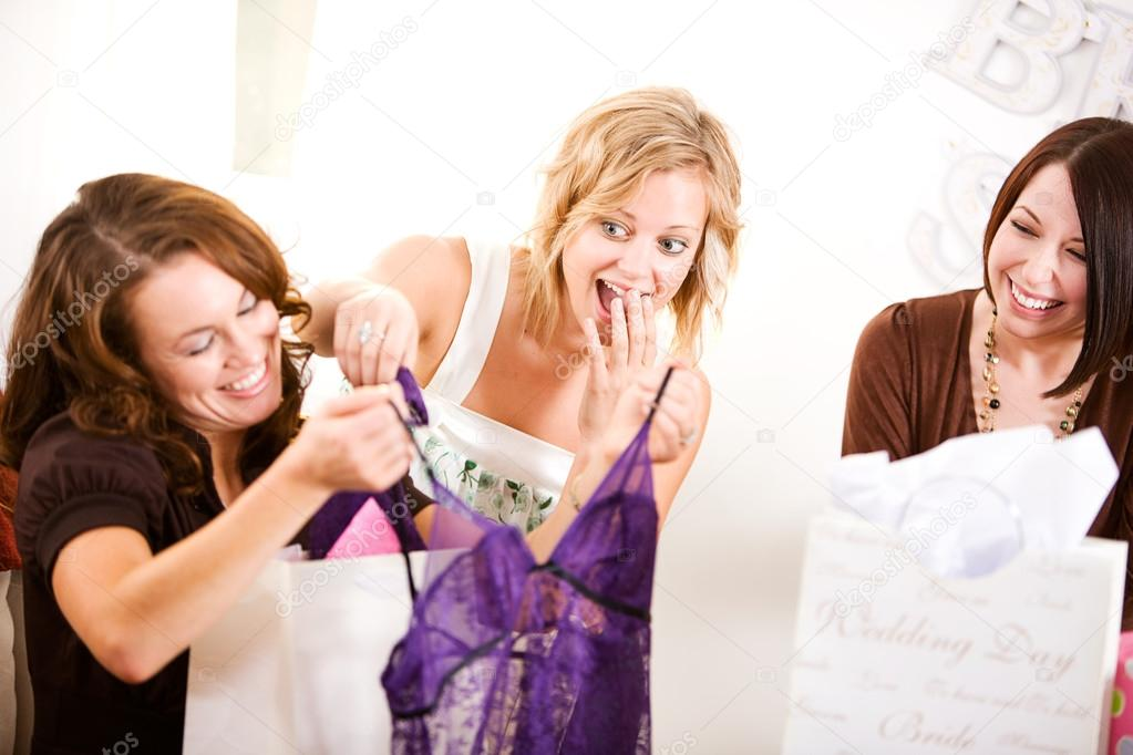bridal shower guest laughs at gift of lingerie stock photo 27514371