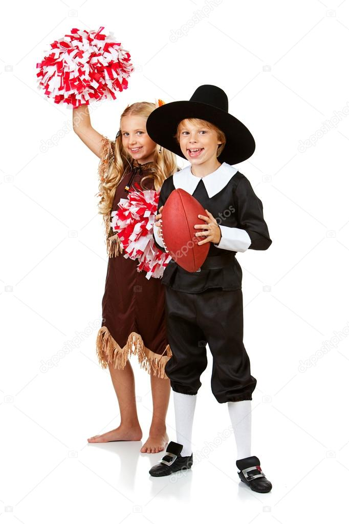 Series With Children Dressed In Costume To Celebrate The American Thanksgiving Holiday Boy As Pigrim Girl Native