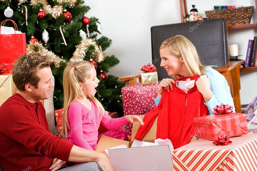 christmas family opening christmas presents stock photo