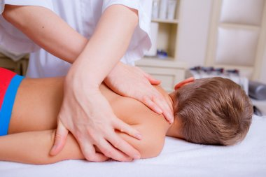 Boy getting back massage