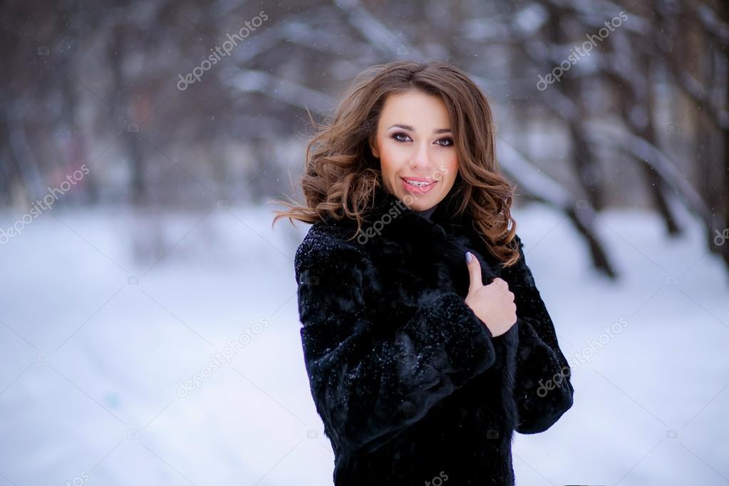 Girl in fur coat in winter.