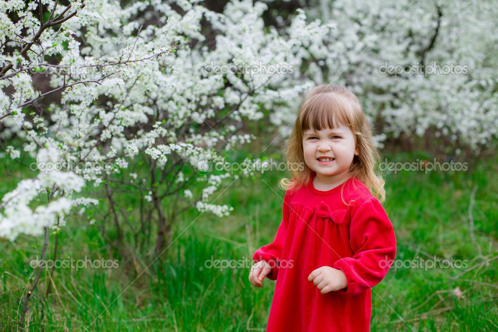 Little girl walking in the  spring park