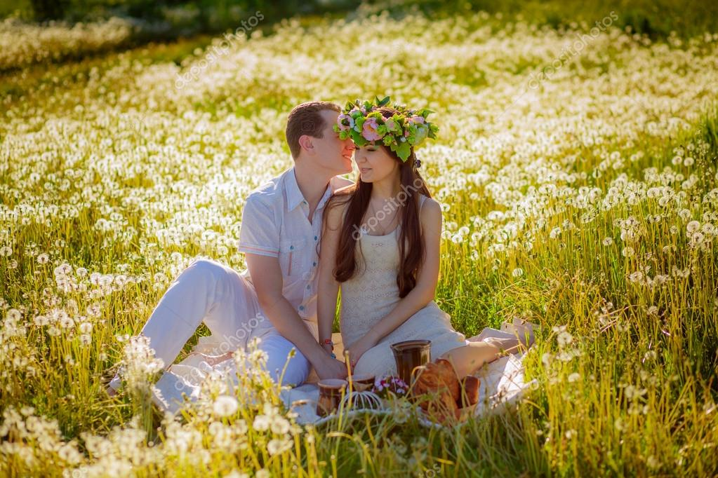 Couple relaxing on the meadow