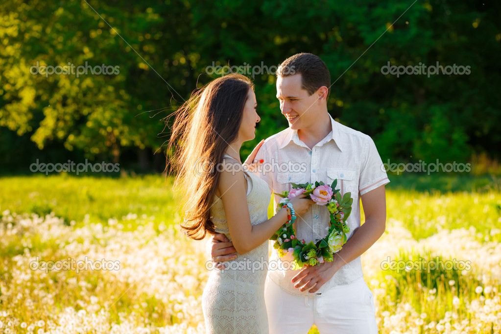 Happy couple  on a field