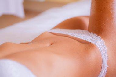 Girl  applying body scrub