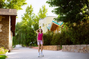 Girl riding rollerblading on a summer day