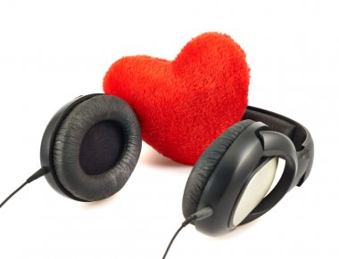 Headphones next to a plush red heart composition isolated over white background stock vector