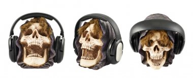 Headphones put on a ceramic skull head