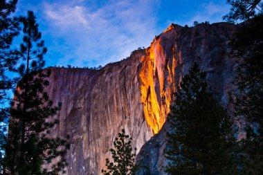 Horsetail falls lit up during sunset in Yosemite National Park,California