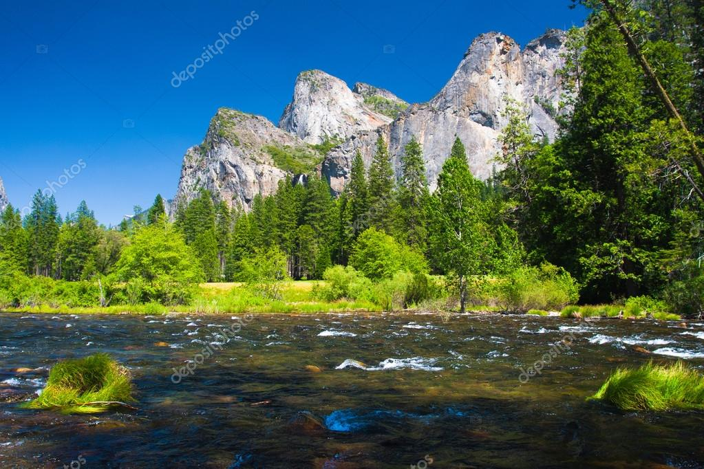 Three Brothers Rock and Merced River in Yosemite National Park, California