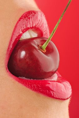 Red lips with cherry on red