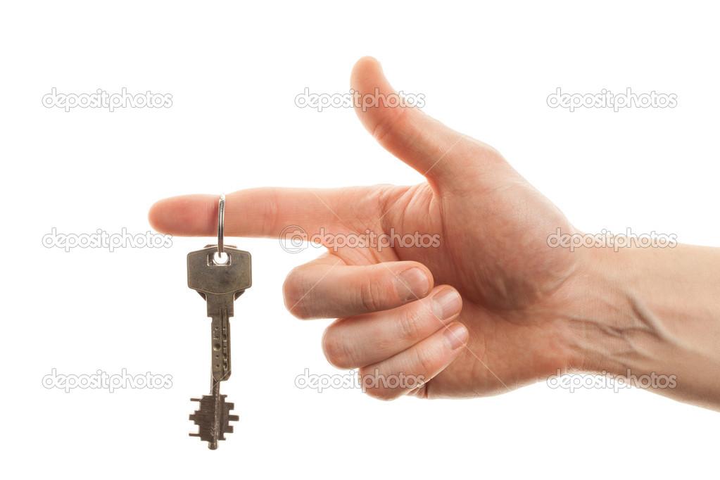 Een Nieuw Huis : Hand met de sleutel van een nieuw huis u2014 stockfoto © axesor #41501441