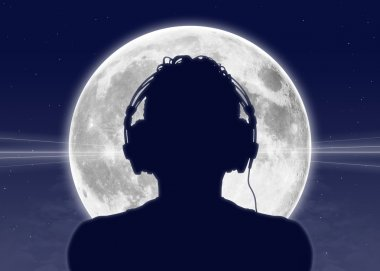man listening to the music at the full moon