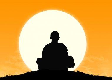 monk in meditation at sunrise