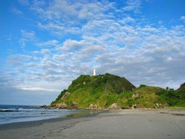 Wild beach and lighthouse at Ilha do Mel (Honey Island) near Cur