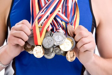 Sports man with lot of medals
