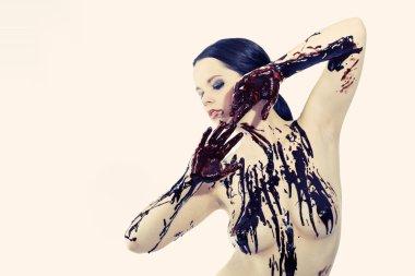Woman tasting liquid chocolate