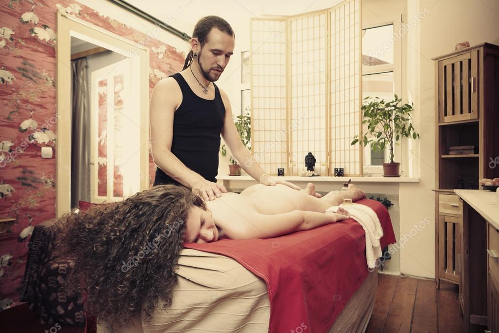 Woman getting healing tantra massage in studio