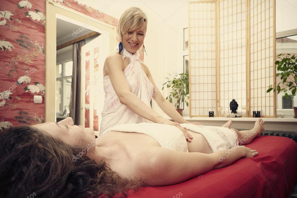 Tantra massager gives a massage to the client