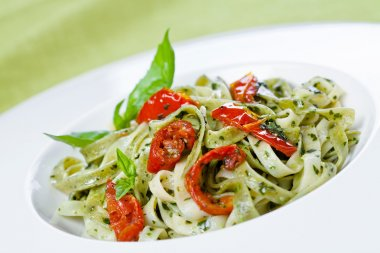 Pasta with pesto and sun-dried tomatoes