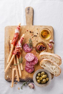 Bread sticks with ham and salami