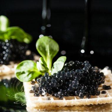 Snack with black caviar