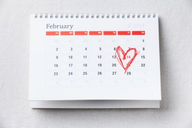 Calendar with 14 February date Valentine's day with red heart shape marker stock vector