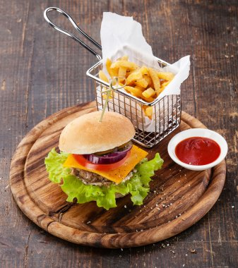 Burger and French fries in basket
