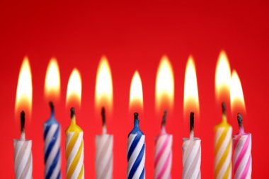 Birthday candles on red