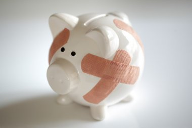 Piggy bank with band aids