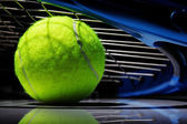 Photo Tennis racket and ball