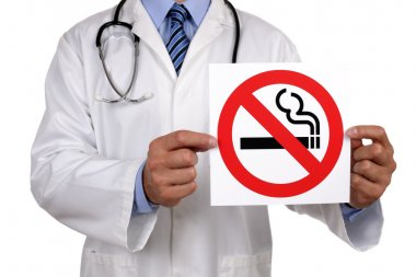 Doctor with no smoking sign