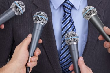 Press conference with media microphones held in front of business man, spokesman or politician stock vector