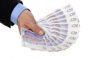 Holding twenty pound notes