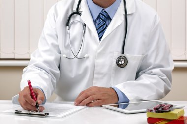 Doctor writing a prescription or medical examination notes