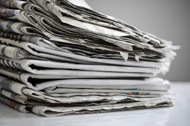 Daily newspapers stacked in a heap stock vector