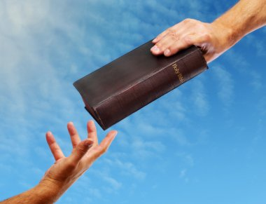 Passing over the bible hand giving a bible to another reaching out stock vector
